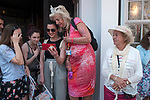 Royal Wedding of Prince Harry and Megham Markle, 19th May 2018. Windsor Berkshire. Older patriotic woman wearing crown  watching procession on iphone.