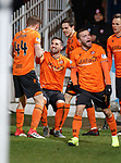 08.11.2019 Dundee v Dundee Utd: Nicky Clark mobbed after scoring penalty