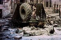 UNGARN, 10.1956.Budapest, VIII. Bezirk.Ungarn-Aufstand / Hungarian uprising 23.10.-04.11.1956:.Tote, mit Chlor ueberstreute Sowjetsoldaten an ihrem zerschossenen Panzerwagen in der Práter Str. unweit des Corvin-Komplexes, der eine Hauptbastion der Aufstaendischen war, nach dem Waffenstillstand vom 28.10.56..Corpses of Soviet soldiers behind their destroyed armoured vehicle in Prater street not far from the Corvin complex, one of the main strongholds of the insurgents, after the ceasefire of oct. 28..© Jenö Kiss/EST&OST