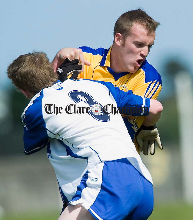 Clare's Stephen Hickey is tackled by Waterford's Thomas O Gorman during their senior championship game in Dungarvan. Photograph by John Kelly.