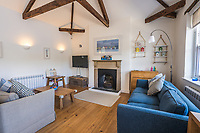 BNPS.co.uk (01202 558833)<br /> Pic: March&Petit/BNPS<br /> <br /> Pictured: The living room.<br /> <br /> The ultimate riverside lifestyle is up for grabs with this waterfront home on the market for £3m.<br /> <br /> Rosebank is in an unrivalled spot on the banks of the River Dart, close to a historic church and castle, with spectacular views over the water.<br /> <br /> The three-bedroom property in Dartmouth, Devon, has its own boathouse and direct access to the river, as well as a superb riverside terrace.<br /> <br /> The house is close to the mouth of the river, with St Petrox Church and Dartmouth Castle as its neighbours, which are just visible from the veranda.