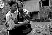 Morina, Kosovo  <br /> 1999<br /> <br /> Elmi Zymjeri (left) and his brother Hexhmedin Zymeri (right) break into tears as they return to find a mass grave where their father, Qerim and brother Azem were executed and buried by Serb military.