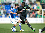 St Johnstone v Celtic....15.09.12      SPL  .Chris Millar holds off Victor Wanyama.Picture by Graeme Hart..Copyright Perthshire Picture Agency.Tel: 01738 623350  Mobile: 07990 594431