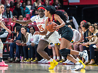 COLLEGE PARK, MD - FEBRUARY 9: Ashley Owusu #15 of Maryland closes in on Arella Guirantes #24 of Rutgers during a game between Rutgers and Maryland at Xfinity Center on February 9, 2020 in College Park, Maryland.