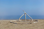 Sculpture on beach made of driftwood at East Beach  Park on Marrowstone Island, Salish Sea, Admiralty Inlet, Puget Sound, Washington.  Represented by www.spacesimages.com