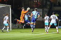 Sam Howes of West Ham United U21s comes off his goal line to collect the ball ahead of Scott Kashket of Wycombe Wanderers during the The Checkatrade Trophy match between Wycombe Wanderers and West Ham United U21 at Adams Park, High Wycombe, England on 4 October 2016. Photo by David Horn.
