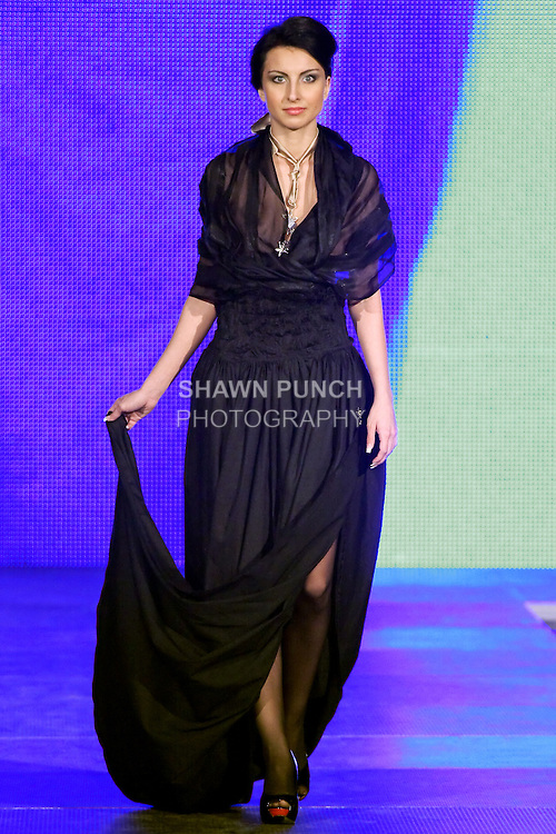 Model walks runway in an outfit from the Lea Fekete collection by Lea Fekete, during the Factory Fashion Show 2012, organized by Ina Budovksa in Trencin Slovakia, May 3, 2012.
