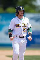 Clint Frazier (20) of the Lynchburg Hillcats walks off the field between innings of the game against the Frederick Keys at Calvin Falwell Field at Lynchburg City Stadium on May 14, 2015 in Lynchburg, Virginia.  The Hillcats defeated the Keys 6-3.  (Brian Westerholt/Four Seam Images)