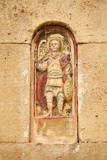 Close up picture & image of a relief sculpture on the exterior of the Gelati Georgian Orthodox Church St George, 13th.  The medieval Gelati monastic complex near Kutaisi in the Imereti region of western Georgia (country). A UNESCO World Heritage Site.