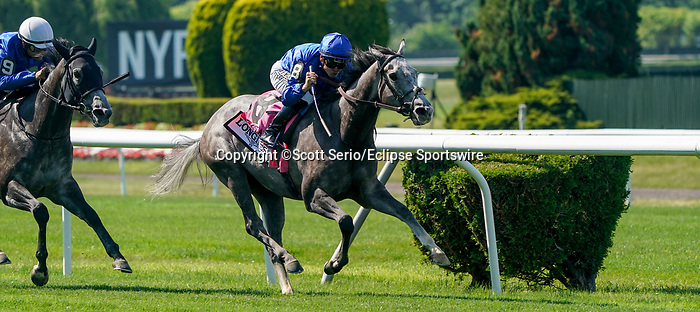 June 5, 2021: Althiqa, #8, ridden by jockey Mike Smith, wins the Longines Just a Game Stakes on Belmont Stakes Day at Belmont Park in Elmont, New York. Scott Serio/Eclipse Sportswire/CSM