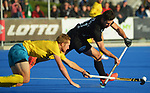 Australia's Dane Beale tries to tackle Kane Russell (right) during the Sentinel Homes Trans Tasman Series hockey match between the New Zealand Black Sticks Men and the Australian Kookaburras at Massey University Hockey Turf in Palmerston North, New Zealand on Sunday, 30 May 2021. Photo: Dave Lintott / lintottphoto.co.nz