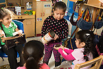 Education preschool 3-4 year olds group of girls playing game in pretend play area