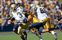 Sean Cattouse (right) tackles Josh Smith (3) on the play. The California Golden Bears defeated the UCLA Bruins 35-7 at Memorial Stadium in Berkeley, California on October 9th, 2010.