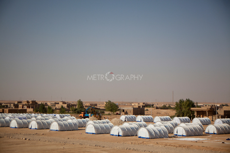 QAIM, IRAQ: The Qaim refugee camp for refugees fleeing the violence in Syria..Over 4,450 Syrian refugees have fled the violence in Syria and are living in the Qaim refugee camp in Iraq...Photo by Ali Arkady/Metrography