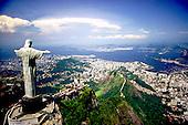 Rio de Janeiro, Brazil. Christ Statue, aerial shot with the Morro Dona Martha and Guanabara Bay behind. Corcovado mountain.