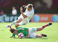 Abby Wambach goes over Mexico's Alina Garciamendez during a collision. .USA 3-0 over Mexico in San Diego, California, Sunday, March 28, 2010.