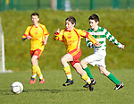 Cathal Darcy of Avenue United in action against 10 of Knocklyon FC during their SFAI game at Lisdoonvarna. Photograph by John Kelly.