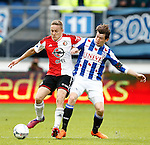 Nederland, Heerenveen, 21 mei 2015<br /> Seizoen 2014-2015<br /> SC Heerenveen-Feyenoord<br /> Jens Toornstra van Feyenoord en Marten de Roon, aanvoerder van SC Heerenveen