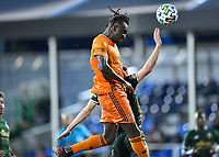 LAKE BUENA VISTA, FL - JULY 18: Alberth Elis #7 of the Houston Dynamo rises above an opponent to win a header on a corner during a game between Houston Dynamo and Portland Timbers at ESPN Wide World of Sports on July 18, 2020 in Lake Buena Vista, Florida.