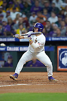 Cade Beloso (24) of the LSU Tigers squares to bunt against the Texas Longhorns in game three of the 2020 Shriners Hospitals for Children College Classic at Minute Maid Park on February 28, 2020 in Houston, Texas. The Tigers defeated the Longhorns 4-3. (Brian Westerholt/Four Seam Images)