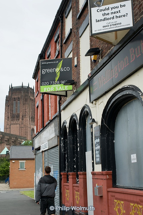 An empty pub and off-licence in Liverpool 8, close to the Anglican Cathedral and city centre.