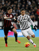 Calcio, Serie A: Juventus vs Milan. Torino, Juventus Stadium, 21 novembre 2015. <br /> Juventus Hernanes, right, is challenged by AC Milan's Riccardo Montolivo during the Italian Serie A football match between Juventus and AC Milan at Turin's Juventus stadium, 21 November 2015. Juventus won 1-0.<br /> UPDATE IMAGES PRESS/Isabella Bonotto