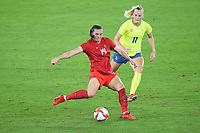 YOKOHAMA, JAPAN - AUGUST 6: Vanessa Gilles #14 of Canada is marked by Stina Blackstenius #11 of Sweden during a game between Canada and Sweden at International Stadium Yokohama on August 6, 2021 in Yokohama, Japan.