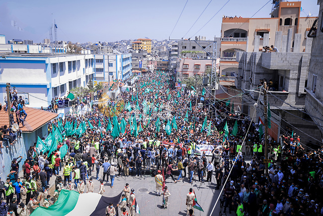 Palestinian supporters of Hamas movement demonstrate against postponement of the Palestinian parliamentary and presidential elections, calling for holding elections on planned date in Jabalia in the nothern Gaza Strip on April 30, 2021. Palestinian President Mahmoud Abbas announced early Friday that the legislative elections scheduled for May 22 will be postponed until further notice. Photo by Anas al-Sharif
