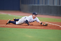 GCL Yankees East first baseman Jhoiner Rodriguez (29) dives to tag the bag during a Gulf Coast League game against the GCL Phillies East on July 31, 2019 at Yankees Minor League Complex in Tampa, Florida.  GCL Phillies East defeated the GCL Yankees East 4-3 in the second game of a doubleheader.  (Mike Janes/Four Seam Images)