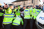 © Joel Goodman - 07973 332324 . 11/12/2010 . Peterborough , UK . Protesters clash with police as the English Defence League ( EDL ) hold a demonstration in Peterborough . Photo credit : Joel Goodman