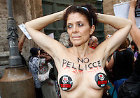 Animalisti Italiani protestano contro la presenza dello stilista francese Jean-Paul Gaultier alla rassegna Altaroma, a Roma, 7 luglio 2013.<br /> Animal rights activists protest against the presence of the French Stylist Jean-Paul Gaultier at the Altaroma high-fashion week in Rome, 7 July 2013.<br /> UPDATE IMAGES PRESS/Riccardo De Luca