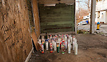WATERBURY,  CT-123016JS04--A makeshift memorial sits on the porch of a home on High Street on Friday. A person was shot in his car near 60 High Street in Waterbury on Thursday and later died of his injuries. <br /> Jim Shannon Republican-American