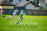 Ivan Conway of Lixnaw about to take a score as Jack Doyle of Tralee Parnells tries to block his effort, in the Minor hurling championship quarter final.