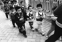 School children being tied up on the way to school, to avoid being stolen. Thousands of migrant mothers' children have been stolen and sold to rich families desperate for a boy. Families are limited to a single child under the China's ruthless One Child Policy...PHOTO BY SINOPIX