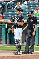 John Hester (22) of the Salt Lake Bees behind the plate with home plate umpire Kolin Kline in action against the Sacramento River Cats at Smith's Ballpark on June 6, 2014 in Salt Lake City, Utah.  (Stephen Smith/Four Seam Images)