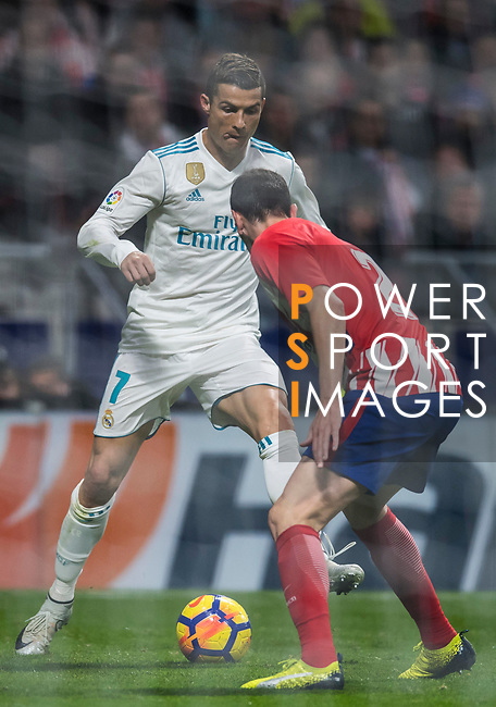 Cristiano Ronaldo of Real Madrid competes for the ball with Diego Roberto Godin Leal of Atletico de Madrid during the La Liga 2017-18 match between Atletico de Madrid and Real Madrid at Wanda Metropolitano  on November 18 2017 in Madrid, Spain. Photo by Diego Gonzalez / Power Sport Images
