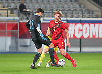 Ewoud Pletinckx (4) of Belgium blocks the access to the ball while goalkeeper Senne Lammens (12) of Belgium comes to kick it away during a soccer game between the national teams Under21 Youth teams of Belgium and Kazakhstan on the third matday in group I for the qualification for the Under 21 EURO 2023 , on friday 8 th of october 2021  in Leuven , Belgium . PHOTO SPORTPIX | SEVIL OKTEM