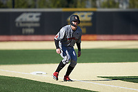 Luke Brown (8) of the Louisville Cardinals takes his lead off of third base against the Wake Forest Demon Deacons at David F. Couch Ballpark on March 7, 2020 in  Winston-Salem, North Carolina. The Demon Deacons defeated the Cardinals 3-2. (Brian Westerholt/Four Seam Images)