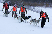 """A team of Norwegian """"Outdoor Education Students"""" based in Takotna for the winter help park a team at the Takotna checkpoint on Wednesday"""