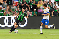 AUSTIN, TX - JUNE 19: Jared Stroud #20 of Austin FC brings the ball up the field with Oswaldo Alanis #4 of the SJ Earthquakes defending during a game between San Jose Earthquakes and Austin FC at Q2 Stadium on June 19, 2021 in Austin, Texas.