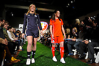 Washington Freedom players Allie Long and Sarah Huffman walk down the runway during the unveiling of the Women's Professional Soccer uniforms at the Event Place in Manhattan, NY, on February 24, 2009. Photo by Howard C. Smith/isiphotos.com