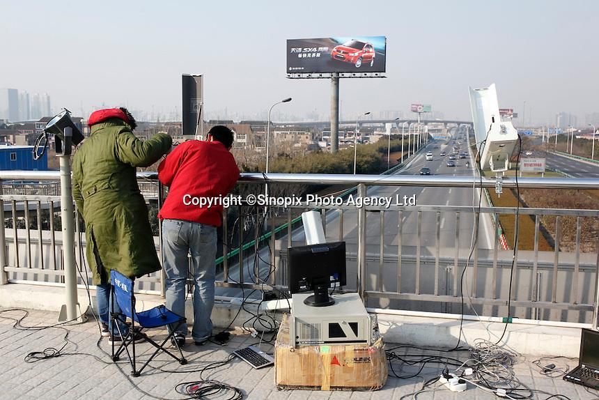 Technicians install traffic cameras in Shanghai, China..13 Jan 2009