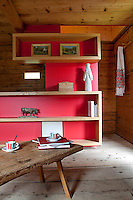 In the living room contemporary open shelving in solid oak displays sculptures from the 1930s by Jean Casanova