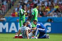 Sergio Aguero of Argentina is seen by medics and taken off injured
