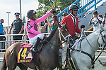 Jockey Patrick Husbands celebrates aboard Lexie Lou(14)  his victory at the 155th Queen's Plate at Woodbine Race Course in Toronto, Canada on July 06, 2014.