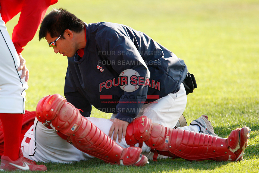 July 19, 2009:  Trainer Manabu Kuwazuru of the Batavia Muckdogs during a game at Dwyer Stadium in Batavia, NY.  The Muckdogs are the NY-Penn League Short-Season Class-A affiliate of the St. Louis Cardinals.  Photo By Mike Janes/Four Seam Images