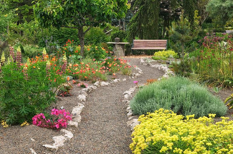 Gravel path and bench at Northwest Garden Nursery, Eugene, Oregon