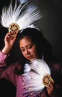 Portrait of a Yupik woman posing with traditional fans. Alaska.
