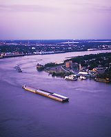 aerial photograph of barges on the Mississippi River, New Orleans, Louisiana at dusk