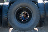 MR / Schenectady, NY. Rosendale Elementary School. Student (girl, 6, African American) inside tire structure on playground at freetime. MR: Mos4. ID: AJ-LC. © Ellen B. Senisi
